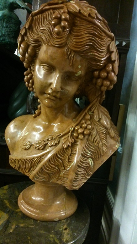 Bust of Young Girl with Grape leaves