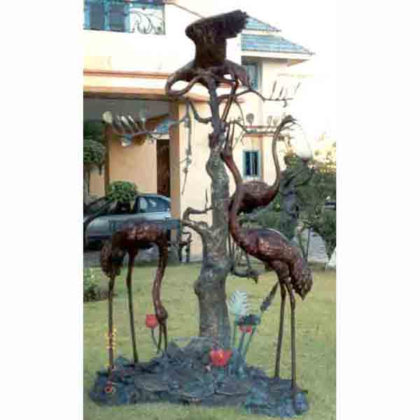 Four Bronze Cranes by a Tree
