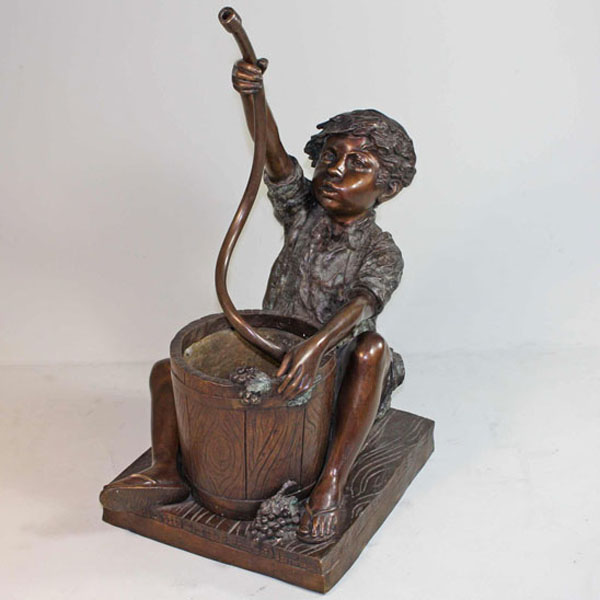 Bronze sitting Boy with Hose and Bucket Fountain
